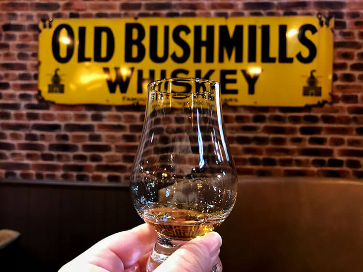 A taste of whiskey in the Old Bushmills Distillery bar to end the tour