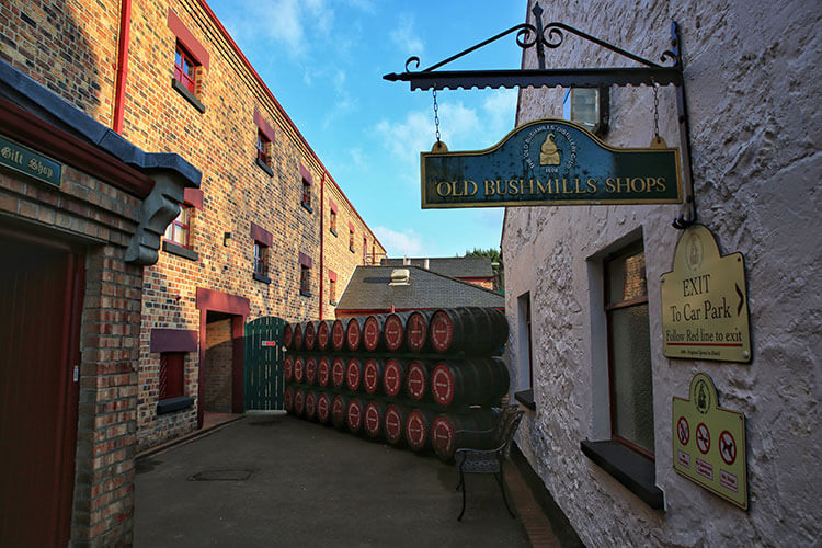 Casks are stacked outside near the gift shop and entry to the Old Bushmills Distillery