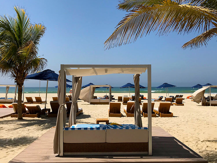 A cabana on the private beach at Al Baleed Resort by Anantara