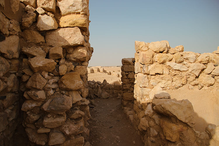 Inside one of the towers with a close up of the building stones used at Ubar