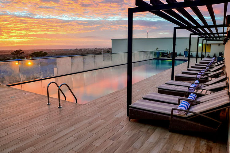 The rooftop infinity pool at sunrise at Hilton Garden Inn Nairobi Airport