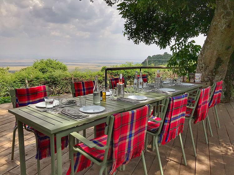 The table set under the shady moth trees in the Shamba at Angama Mara
