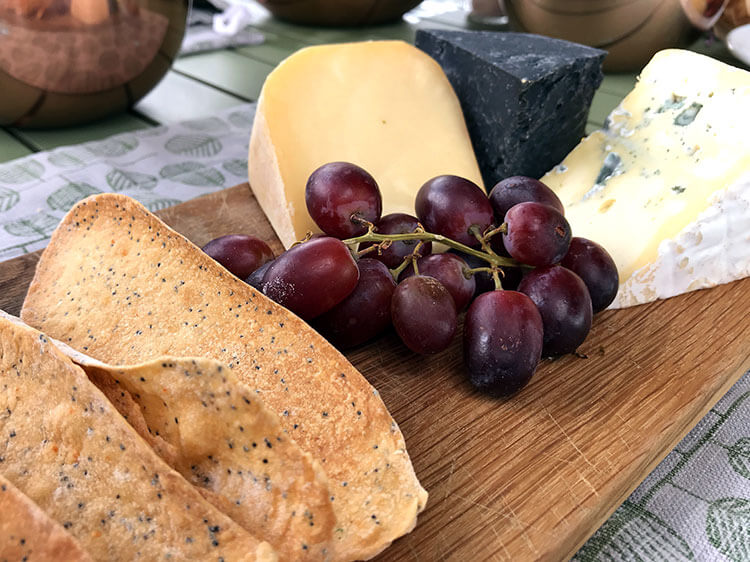 A trio of cheeses with grapes to enjoy with the Shamba lunch at Angama Mara