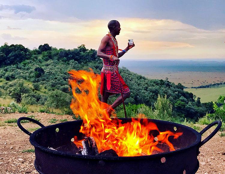 A Maasai tribesman looks out over the Masai Mara