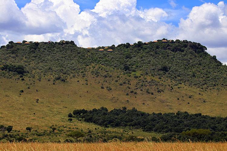 The tents of Angama Mara dot the escarpment as seen from the Mara floor