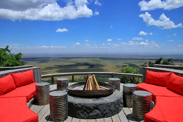 The main lodge has a deck with fire pit that looks out over the Masai Mara
