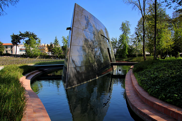 The 21st century winery designed by Philippe Starck looks like an upside down ship suspended in water at Château Les Carmes Haut-Brion