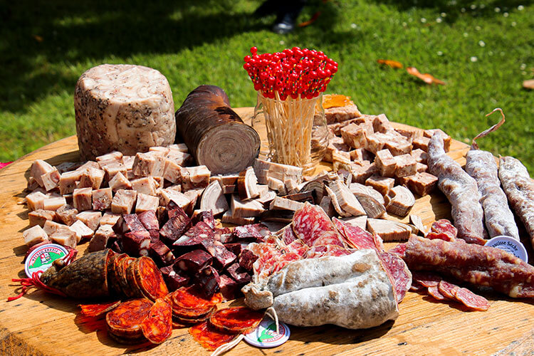 A charchuterie board of various salamis during the picnic lunch at Château Malescasse