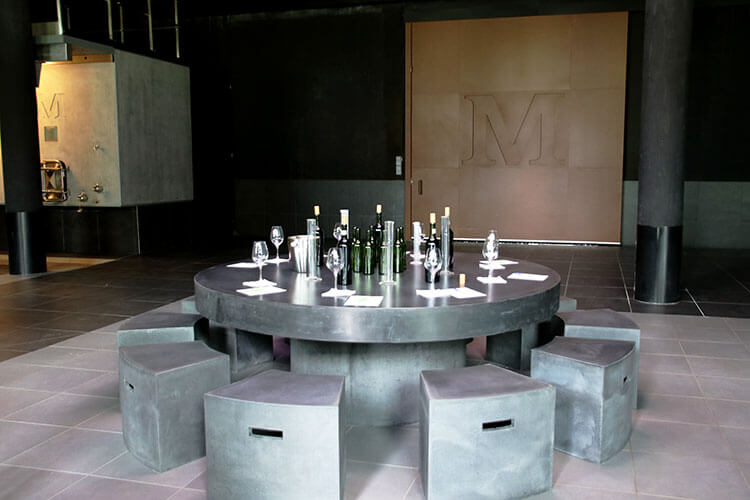 Cellar master workshop set up with beakers, worksheets and the wines in the cellar at Château Malescasse