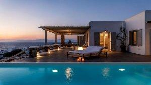 The pool at sunset at Villa Temptation in Mykonos