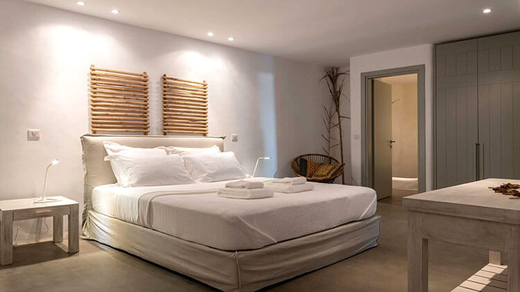 The bedroom at Villa Temptation in Mykonos with cream colors and minimalist design