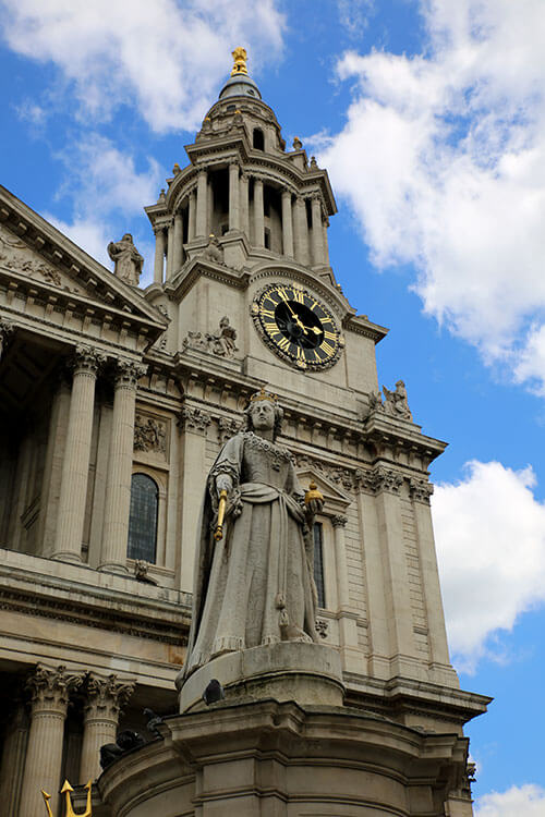 The statue of Queen Anne with the towers of St. Paul's Cathedral rising up behind her in London