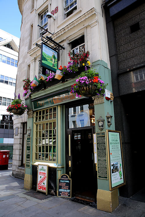 The exterior of The Tipperary, which is green and decorated with shamrocks and flowers