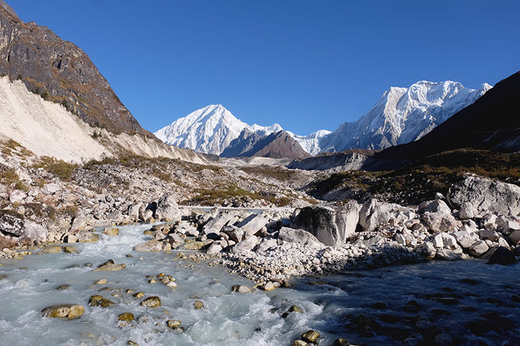 A glacial river runs through the arid landscape on the Manaslu Circuit Trek in Nepal