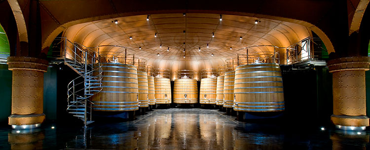 The vat room with an arc of oak vats at Vivanco in La Rioja, Spain