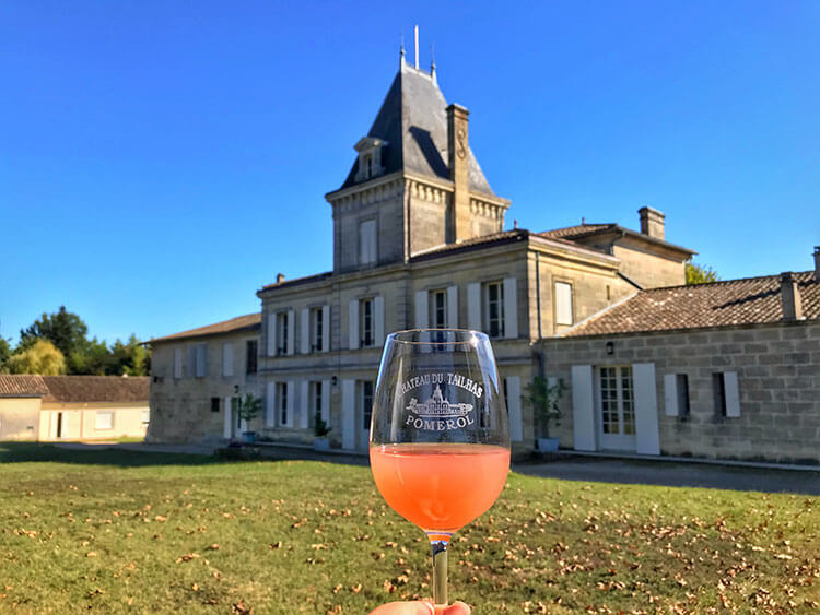 A glass of freshly crushed Merlot grape juice is the color of watermelon juice at Chateau du Tailhas in Pomerol
