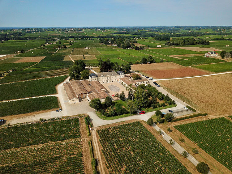 An aerial drone view of Chateau Soutard and the surrounding vines in Saint-Émilion