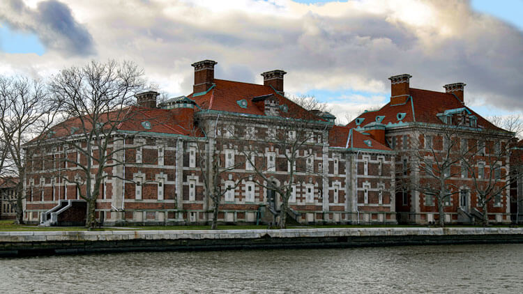 The exterior of the red brick Ellis Island Hospital Complex