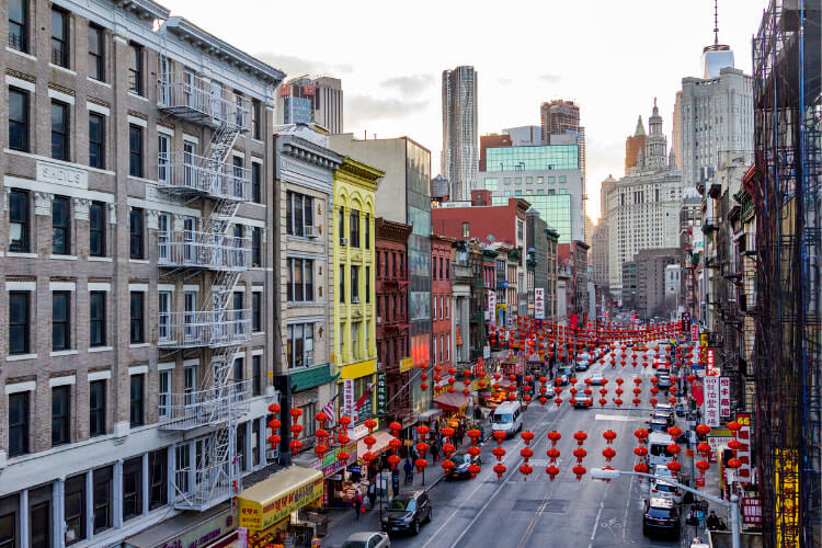 A view of Chinatown with Chinese lanterns hanging over the street in NYC