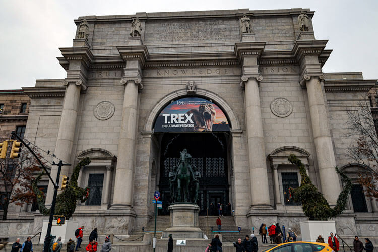 The exterior of the American Museum of Natural History with the Teddy Roosevelt statue in the center of the entry