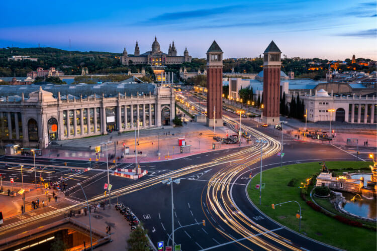 Plaça d'Espanya at blue hour with light trails from the traffic