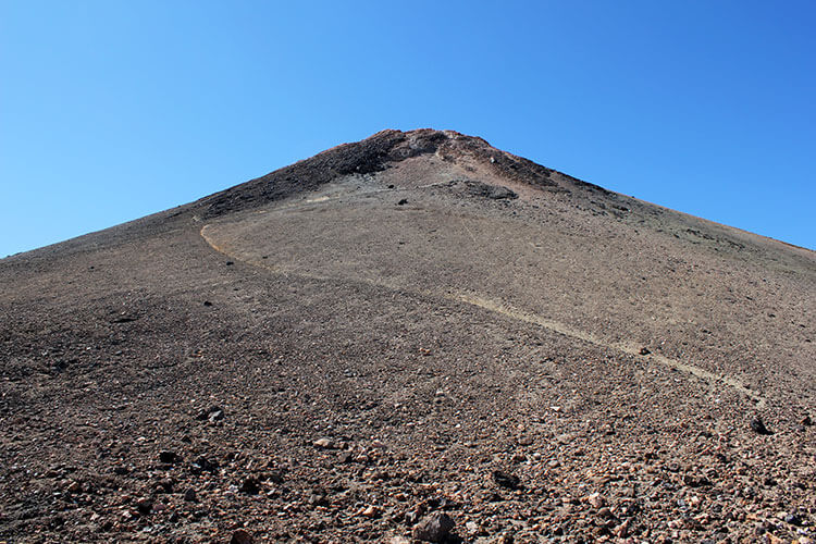 On the lava rock cone of the summit of Mount Teide in Tenerife