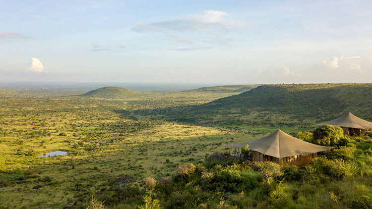 Two of the individual tents sit on an escarpment above the Laikipia plains at Loisaba Lodo Springs