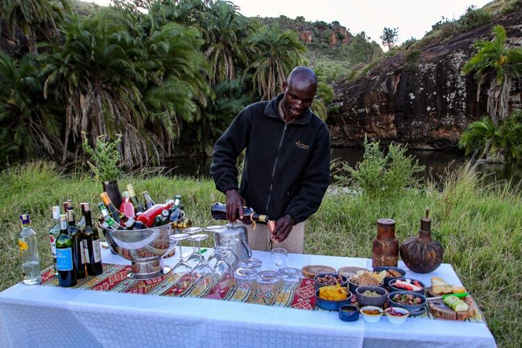 An Elewana Collection employee pours Amarula at the sundowner bar in Loisaba Conservancy