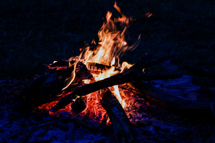 A campfire burns in Loisaba Conservancy