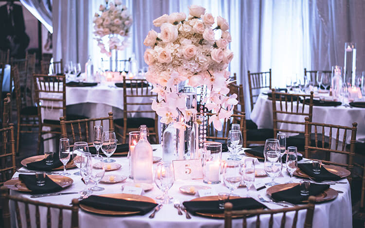 Pink and white rose centerpiece on table in wedding venue
