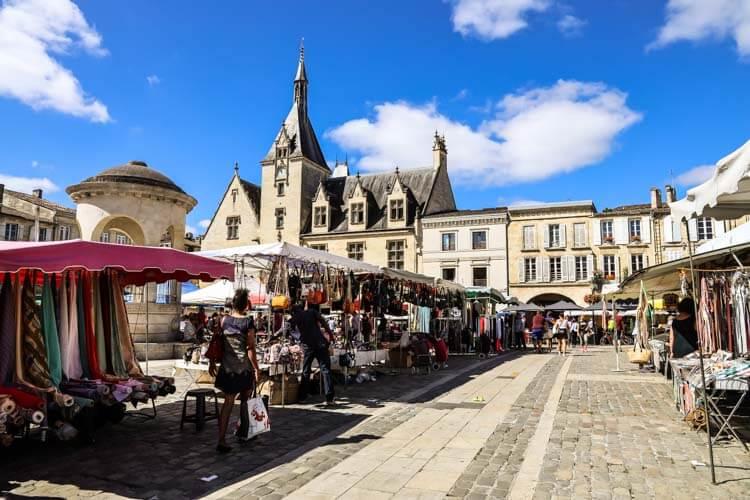 Market stalls set up on Place Abel Surchamp in Libourne, France