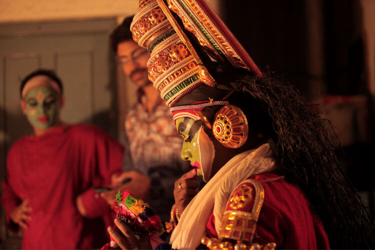 Kathakali performers dressed up in elaborate costumes