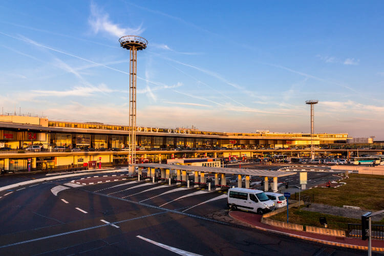 Paris Orly Airport as seen from outside with a tower and departures drop off