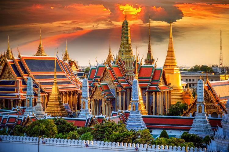 The various buildings of the Grand Palace in Bangkok at sunset