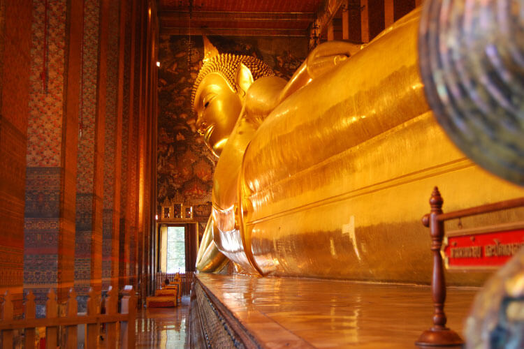 The Reclining Buddha stretches the length of the Wat Pho in Bangkok