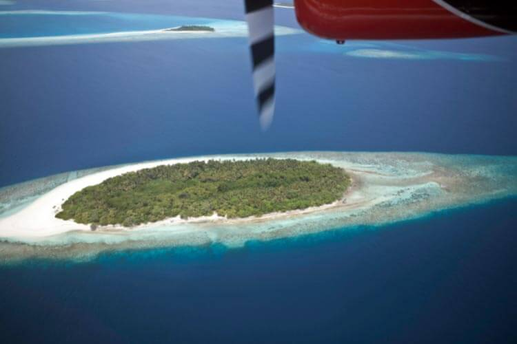 Spotting islands and atolls from a seaplane transfer in the Maldives