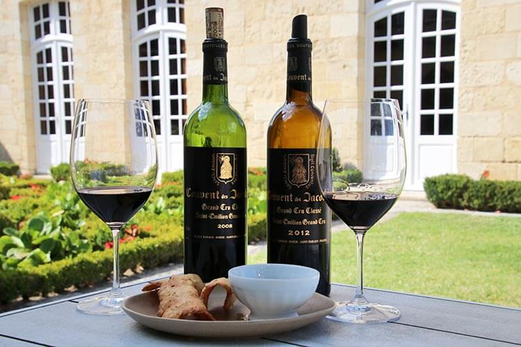 A tasting of two wines of Couvent des Jacobins paired with chocolate and pastries in the garden of the winery in Saint-Émilion