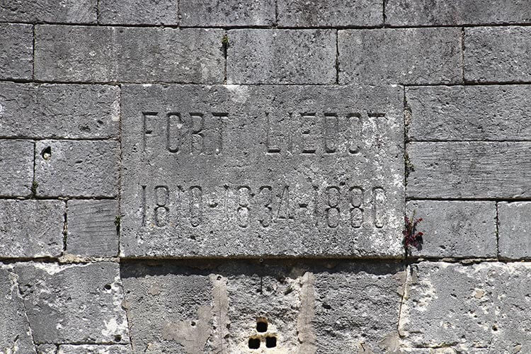 The stone plaque with the dates 1810, 1834 and 1880 on the entrance of Fort Liédot on Île d'Aix